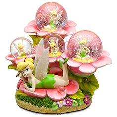 Disney ''Musical Bubbles'' Tinker Bell Snowglobe   Disney Store''Musical Bubbles'' Tinker Bell Snowglobe - Tinker Bell sends lots of lovely fairy bubbles up into the air on this charming, light-hearted ''Musical Bubbles'' Tinker Bell Snowglobe. Four snowglobes feature Tink in different poses and it plays You Can Fly.