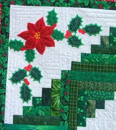 Advanced Embroidery Designs. Christmas Scrap Quilt with applique made on computerized embroidery machines