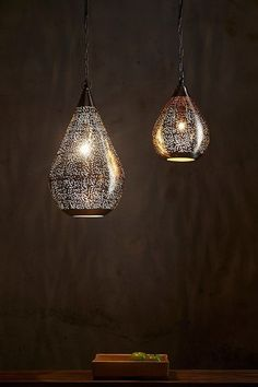 Two sizes of pendants featuring delicately-patterned perforated nickel teapdrop shapes. When unlit the metallic silver exterior shows the delicate perforations, when illuminated the glowing gold interior radiates out. Gold Interior, Interior Lighting, Lighting Ideas, Light Crafts, Pendant Lighting, Delicate, Pendants, Ceiling Lights, Aquarius