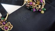 Hello Im happy youre here PANDORA FASHION shop  I offer vintage authentic GIANNI VERSACE bag Made in Italy Gianni Versace tag inside In front of GIANNI VERSACE Strap bags are metallic gol chain inside - very neat and clean   used in very good vintage condition. Inside clean  measures