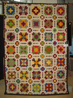 A new twist I haven't seen yet.  I like that she used multicolored one inch squares.  Ingrid Rehme, Lemgo, Patchwork of the Crosses - TOP CLICK!