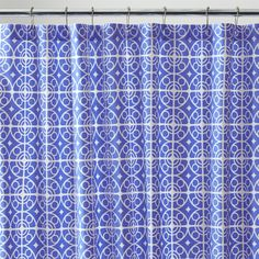 White medallions trellis on deep blue in a Moroccan-inspired pattern printed on sturdy cotton. 100% cottonMachine wash, tumble dry; warm iron as neededUse with shower curtain linerMade in Portugal.