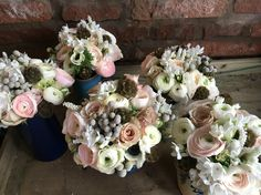 Bridesmaids muted Spring bouquets of roses, anemones, brunia and ranunculus
