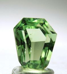 Hiddenite 1.05 carat Size:	 Thumbnail 0.6x0.5x0.4 cm Location:	Hiddenite North Carolina Description:	A fancy cut gem with good clarity and beautiful green color. It weighs 1.05 carat.  Hiddenite is a green variety of Spodumene and has its color due to the Chromium content.  It was originally described from Hiddenite, NC, and it is the favorite locality for collectors.  It is a well cut gem, considering how hard it is to facet Spodumene. It has a nice sparkle too.