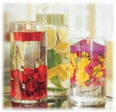Materials Needed:  Glass container or vase  Fresh fruit or flowers  Water  Floating Candles    INSTRUCTIONS:    1. Fill the glass container approximately halfway with desired fruit or fresh flower heads. If using lemons or limes, slice them before placing into the container.    2. Carefully fill the container with water, leaving about 2 inches at the top.    3. Place a floating candle on top of the water.