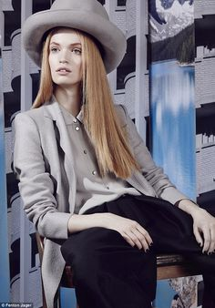 Boiled wool jacket, georgette blouse, wool-mix trousers, and felt hat, all #EmporioArmani