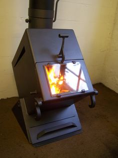The Wedge, available from space heater to a boiler, featured in a Grand Design episode. Coal Stove, Stove Oven, Stove Fireplace, Fireplace Design, Metal Projects, Welding Projects, Shop Heater, Wood Pellet Stoves, Multi Fuel Stove
