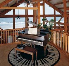 Her favorite spot in the cabin was the loft music room. The baby grand was angled to catch the ocean views and spectacular sunsets. She found an amazing round rug with a piano key motif. And she discovered, upon placing her hands on those much-loved ivories, that the acoustics were surprisingly good. It was a very long way from the concert stage, but it was exactly where she wanted to be.