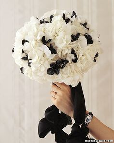 Black-beaded flowers add drama to a pouf of white hydrangeas.