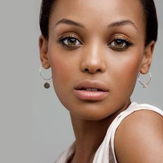 Fresh naturals for tan and brown skin tones include berry hued eyeshadow and blush and coral pink lipstick...