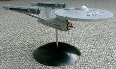 Star Trek Phase II, the series that never made it to the Television screen, but of which turned into Star Trek The Motion Picture! There were several design upgrades done for this show, one of which is seen here by Warren Zoell. Utilizing two Polar Lights kits, he managed to create the Phase II Enterprise…. …