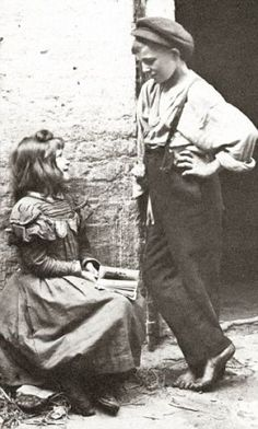 """""""Taken by Horace Warner in 1912 in Spitalfields England, these images of poverty stricken children show the horrible existences they had to endure just to survive."""" - this is the caption.  This looks like flirting to me."""