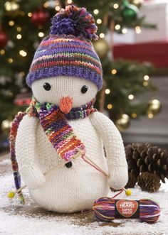 Free Knitting Pattern for Knitting Snowman - This snow knitter softie is a perfect decoration or gift for the knitting household. Or you can leave out the knitting embellishments for a toy or decoration for the non-knitters in your life. The needles are made from skewers and beads and there are also instructions for creating the tiny yarn skein. 12 1/2″ tall. Designed by Nancy Anderson for Red Heart.