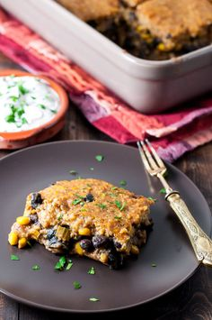 Tomato-free healthy tamale pie. With coarse cornmeal/polenta crust. Healthy --no butter, no gluten, and just enough cheese to do the job.