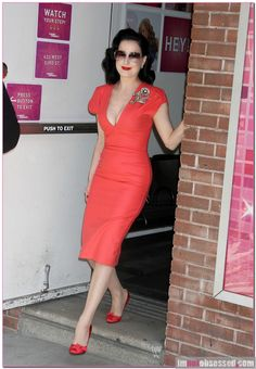 Dita von Teese leaving Wendy Williams Show wearing stunning, orange wiggle dress