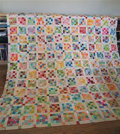 the postage stamp quilt top is finished! and it's king-ish sized! it measures 91 x 91 inches, 169 16-patch blocks, + exactly 2900 two-inch squares. that, friends, is a lot of piecing (no strip piecing, here!)  it feels really good to get this top finished + i'm now anxious to start another scrappy long-term quilt project.