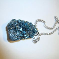 """Silver-Blue Druzy Crystal Necklace This beautiful necklace contains a druzy crystal in a shade of silver-blue on a platinum plated chain. Every crystal is unique, no two are exactly alike. Perfect addition for your outfit or to give to someone you love!   18"""" platinum plated chain  silver-blue druzy crystal pendant    reasonable offers are always welcome   no trades   *listed as Free People for exposure Free People Jewelry Necklaces"""