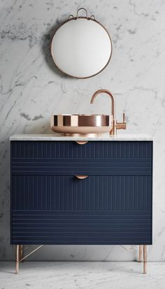 Stylish and modern dark blue bathroom vanity with copper details like sink  || @pattonmelo