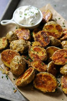 Roasted baby potatoes tossed with Parmesan cheese and baked until crispy and golden brown for a perfect side or fun appetizer Parmesan Roasted Potatoes, Best Appetizers, Vegetable Sides, Vegetarian Cheese, Side Dishes Easy, Golden Brown, Tossed, Veggies, Meals