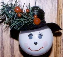 Recycle a light bulb by painting on a snowman face to make a Christmas ornament.