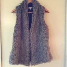 Fur vest with sweater backing Light/ medium brown faux fur vest with light brown sweater material on the back half of the garment.  Very warm! Jackets & Coats Vests
