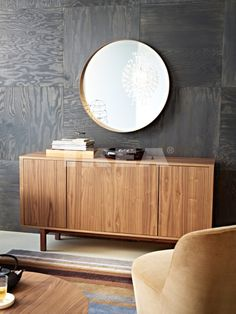Plywood squares mounted on wall in checkerboard pattern. Would look great with a dark gray stain. Cheap, interesting wallcovering idea.