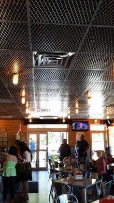 Expanded Metal in place of tiles. You can get the expanded metal from Marco Specialty Steel Gym Design, Roof Design, Retail Design, Basement Ceiling Options, Ceiling Texture, Expanded Metal, Dropped Ceiling, Ceiling Treatments, Metal Ceiling