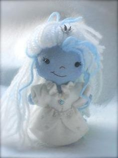 This is Noella the snow princess. She is dressed in an embroidered white gown with poofy sleeves and ruffled collar. Noella is $25 plus 6.00 for shipping (includes international).          https://www.etsy.com/listing/108620756/sweet-little-felt-snow-princess-made-to