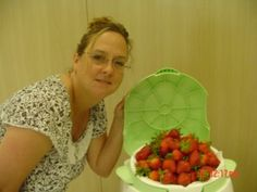potty chair full of strawberries at the baby shower http://bakingmemorieslast.com/2012/01/baby-shower-idea/