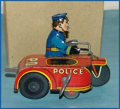 Marx Tin Wind-Up Toy Police Officer on Motorcycle