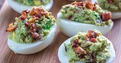 Classic Deviled Eggs Just Can't Compete With This Spicy, Bacon-Topped Variety