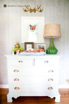 Woodland themed nursery - look at that tiny baby just laying on the dresser - ha!