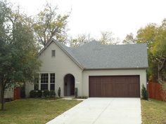 Village Homes: Grey painted brick with dark brown stained garage door. Love it!