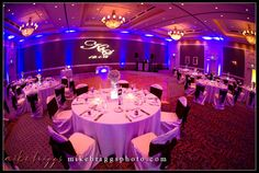 """The Hildebrand newlyweds said """"I Do"""" at the Reunion Resort last December using our monogram lighting and blue uplighting! We especially loved the warm maroon and purple hues that made this wedding look so inviting! View our new blog post for more gorgeous setting photos taken by Mike Briggs & other vendor details! http://wp.me/p2XAl4-Ap"""