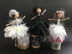 Ballerina Flower Fairy Dolls by MySweetpeanCo These Beautiful Flower fairy ballerina dolls were inspired by Swan Lake Ballet. ..beautiful Black and white costumes. I was inspired by the ballet costume I made 2 of each color and one of the black swan ballerina Materials: White Christmas leaves, Daisy petals, Black Dress, Black feathers, white feathers, Embroidery threads, Black daisy petals, White daisy petals, Ballets shoes, feather head piece..