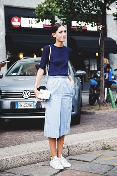 A dark blue long sleeve t-shirt and light blue striped culottes are perfect for both running errands and a night out. A pair of white low top sneakers brings the dressed-down touch to the ensemble.   Shop this look on Lookastic: https://lookastic.com/women/looks/navy-long-sleeve-t-shirt-light-blue-culottes-white-low-top-sneakers-white-and-black-crossbody-bag/10986   — Navy Long Sleeve T-shirt  — White and Black Leather Crossbody Bag  — Light Blue Vertical Striped Culottes  — White Low Top…