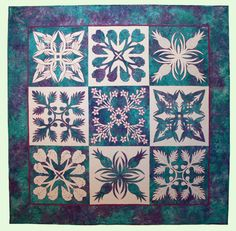 """Nourish the Body, Nourish the Soul, 64 x 64"""", quilt pattern by Sarah Ann Smith: """"Inspired by the beautiful symmetry of Hawaiian quilts and the islands' plants and flowers, I designed this quilt with food-plants and flowers, thing which nourish both body and soul"""""""