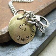 Owned Stamped Metal Handcuff Necklace, brass disc with silver plated chain. $22.95, via Etsy.