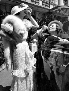 two women outdoors (drinking liquor in seemingly devilish behavior for the times) wearing high fashion dresses including a white fox fur neck piece, United Kingdom, 1934 Vintage Mode, Vintage Ladies, Vintage Style, 1930s Style, Vintage Black, 1930s Fashion, Vintage Fashion, Funky Fashion, High Fashion Dresses