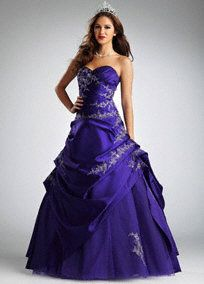 Bring on the drama in this show-stopping ball gown!  Satin sweetheart pleated surplice bodice is ultra feminine and super flattering.  Stunning beaded metallic embroidered lace detail adorns the bodice and skirt.  Ball gown skirt features a mixture of satin and tulle for a look that is utterly breathtaking.  Fully lined. Back zip. Imported polyester. Dry clean only.