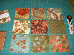 "Here's a little trick using charm squares. Some of you might have seen this before. We all need a refresher now and again...right...LOL. Take 9 charms squares (5"") and layout same way you would for a 9-patch. Did you see that designer rotary cutter??? When I saw this on Nicole's blog I was just so taken by what a neat idea Olfa has finally come out with something pretty...I just had to have one."
