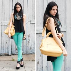 mint jeans, black top, black shoes, colorful scarf, yellow bag