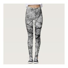 Black and white tree branch print on leggings ($67) ❤ liked on Polyvore featuring pants, leggings, white and black pants, patterned leggings, patterned pants, legging pants and black and white trousers