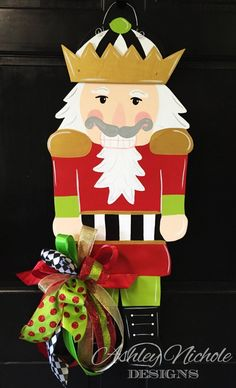 """Make a statement with our large and showy wooden Nutcracker door decoration! This piece is hand cut and hand painted. Made using ¼"""" plywood with a painted back for a more polished look. 34 H x Includes fun bow Christmas Yard, Christmas Signs, Christmas Projects, Holiday Crafts, Christmas Ornaments, Christmas Door Hangers, Christmas Blocks, Christmas Planters, Xmas"""