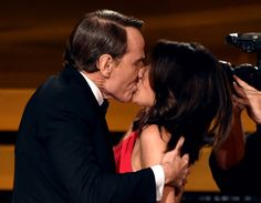 Must-See Moment: Actress Julia Louis-Dreyfus wins Outstanding Lead Actress in a Comedy Series for 'Veep' and kisses actor Bryan Cranston onstage at the 66th Annual Primetime Emmy Awards.
