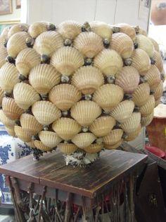 Vintage seashell decorated planter.