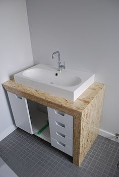 a house in bridgeland Tiny House Design, Modern House Design, Wood Cladding Exterior, Table Furniture, Furniture Design, Osb Plywood, Wet Room Bathroom, Particle Wood, Plywood Projects