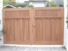 """This double gate is constructed from 2-1/4"""" solid wood with craftsman style details in the wood work. It is an ideal choice for a driveway gate."""