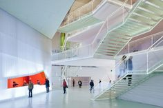 Translucent walls and staircases, highly contrasted by the bleeding red cut that is the reception desk. - Auditorium in Cartagena / Selgas Cano