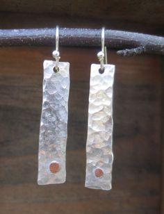 Hammered Silver Earrings with Copper Rivets, Long Silver Earrings, Hammered Jewelry. $40.00, via Etsy.